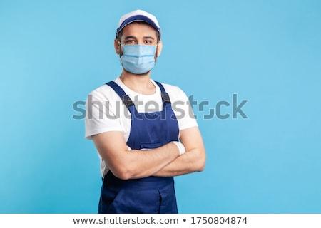Klusjesman werkkleding portret jonge groene Stockfoto © nyul