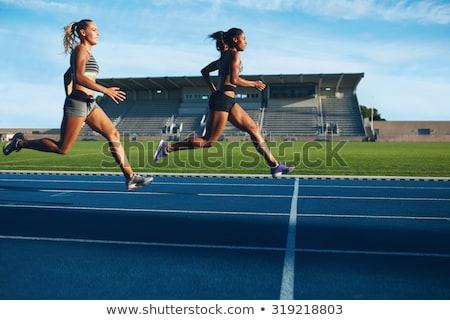 Woman runs in a race to the stadium Stock photo © alphaspirit