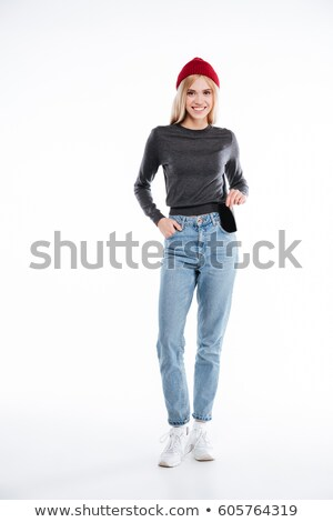 Smiling casual girl taking out blank mobile phone from a pocket Stock photo © deandrobot