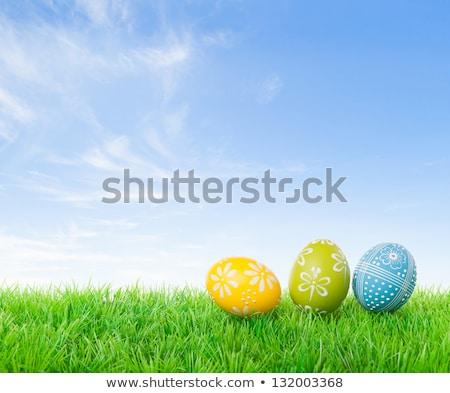 Stock photo: Easter eggs in front of blue sky