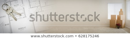 gradated banner with house plans and empty room with boxes stock photo © feverpitch