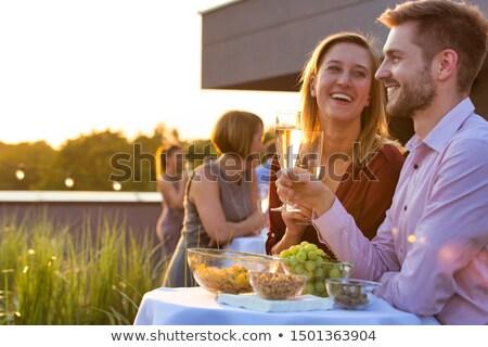 dos · mujeres · fiesta · pie · alimentos · mesa · sonriendo - foto stock © monkey_business