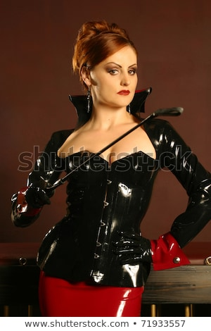 Fetish woman wearing latex corset and skirt  Stock photo © Elisanth