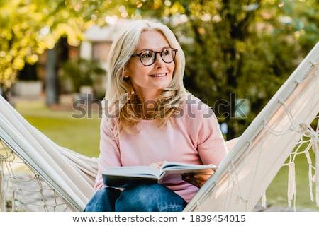 Portré szőke nő visel szemüveg szőke nő fiatal Stock fotó © julenochek