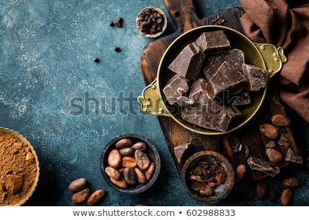 Dark chocolate pieces crushed and cocoa beans, top view Stock photo © yelenayemchuk