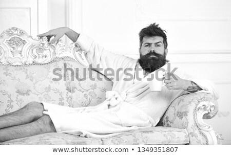 Férfi fürdőköpeny iszik kávé stressz kávéscsésze Stock fotó © IS2