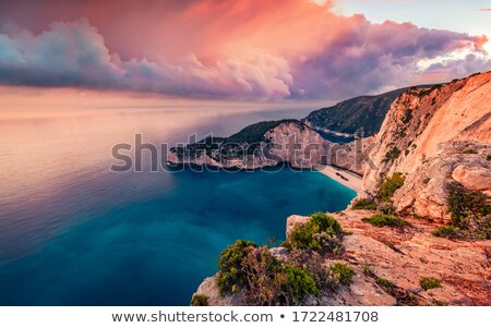 Stok fotoğraf: Shipwreck At Rocky Shore With Sunset At The Sea