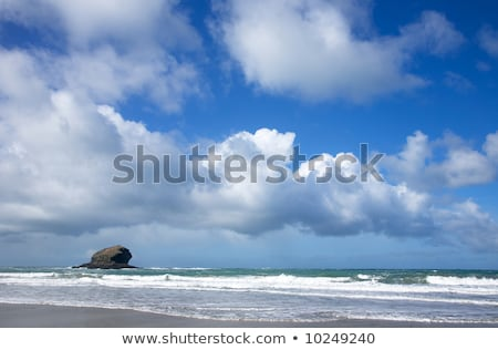 Atlantic clouds and Gull Rock island in Portreath Cornwall UK Stock photo © latent