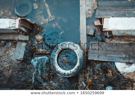 Rubbish, waste floating in polluted pond Stock photo © AlisLuch