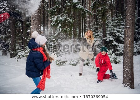 Young woman throws large snowball Stock photo © IS2
