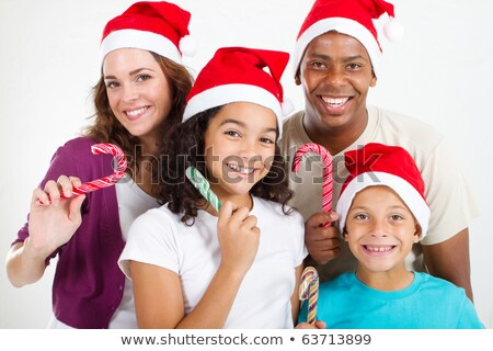 african little boy holding christmas candy cane stock photo © rastudio