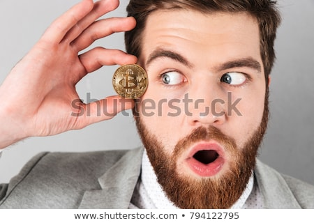 Close up of a curious businessman dressed in suit Stock photo © deandrobot