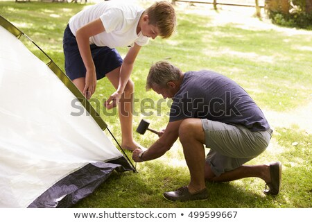 Father and son pitching a tent together Stock photo © IS2