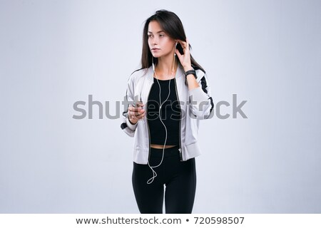 Cropped image of a fitness woman in earphones Stock photo © deandrobot