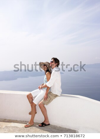 Couple leaning on a low wall, sea view Stock photo © IS2