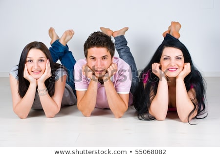 Row of three friends lying down smiling Stock photo © monkey_business