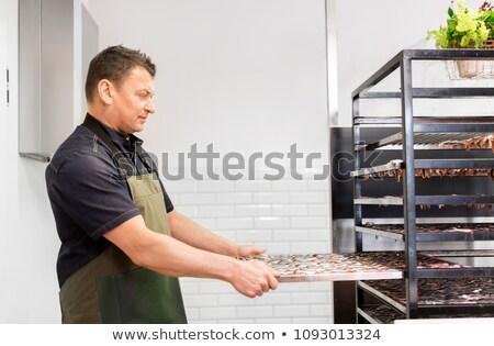 man with smoking tray at fish shop or smokehouse Stock photo © dolgachov