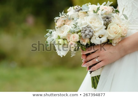 beautiful tender wedding bouquet of cream roses and eustoma flowers in hands of the bride Stock photo © ruslanshramko