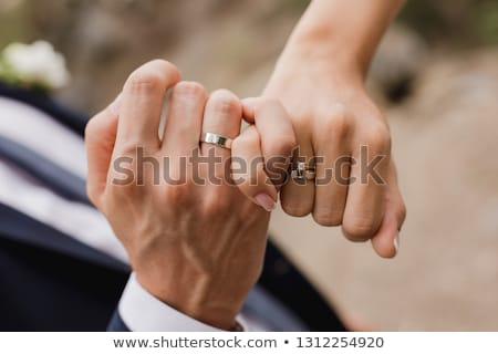 mulher · mãos · anéis · de · casamento · palma · mão - foto stock © ruslanshramko