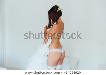 Belo topless noiva em pé cama Foto stock © ruslanshramko