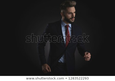 curious smart casual man stepping and looking down to side Stock photo © feedough