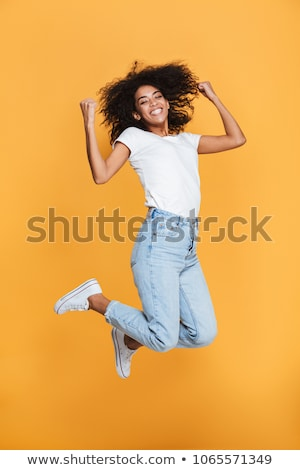 cheerful young woman standing isolated stock photo © deandrobot