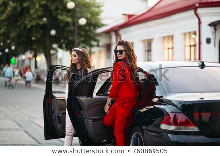 Sylish and beautiful brunette in sunglasses after beauty salon. Stock photo © studiolucky