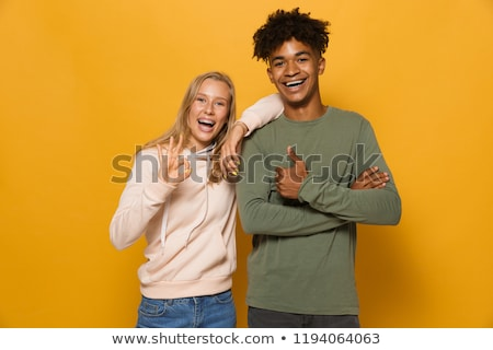 photo closeup of cheerful couple man and woman 16 18 laughing an stock photo © deandrobot