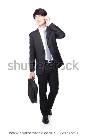Man Carrying Briefcase Talking on Mobile Phone Stock photo © robuart