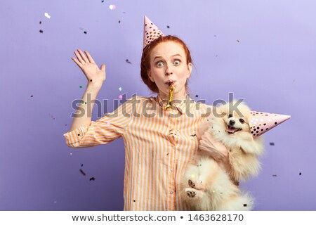 happy women with party caps hugging Stock photo © dolgachov