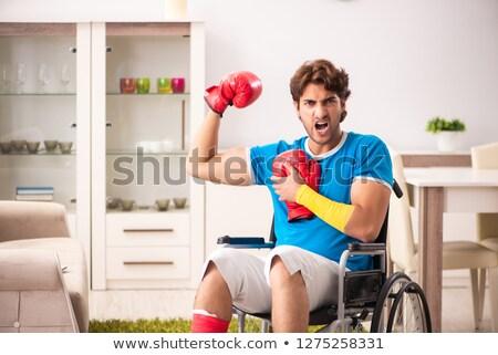 Hombre sesión silla pierna negro Foto stock © feedough
