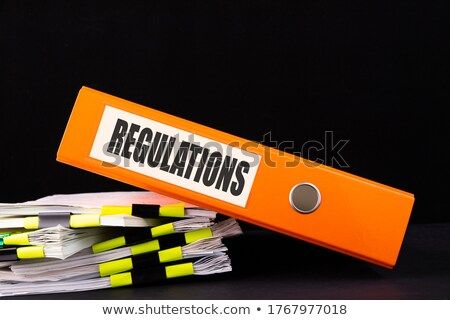 Compliance And Regulation Folder On Office Desk Stock photo © AndreyPopov