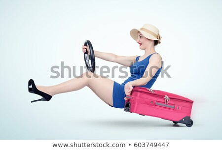 Fashionable ladies going out of the car. Stock photo © studiolucky
