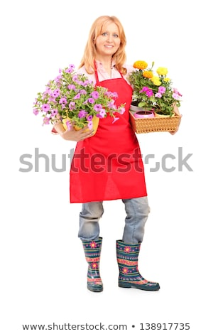 Cheerful florist woman standing with flowers Stock photo © deandrobot