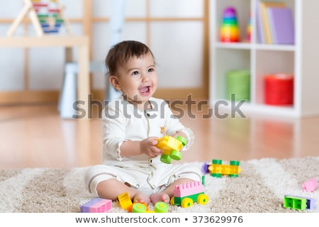 Funny cute happy baby playing on the playground. The emotion of happiness, fun, joy Stockfoto © galitskaya
