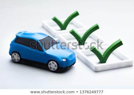 green tick sign near the blue car stock photo © andreypopov