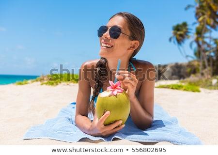 Donna bikini bere cocco acqua spiaggia Foto d'archivio © AndreyPopov
