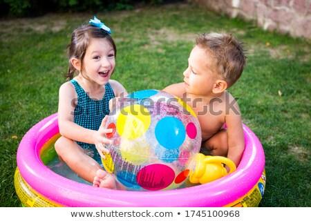Praia jogo menina maiô inflável bola Foto stock © robuart