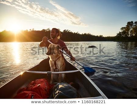 бородатый человека каноэ лодка озеро иллюстрация Сток-фото © jossdiim