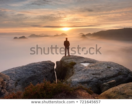 Man Enjoying Freedom Outdoors in Autumn Landscape stock photo © monkey_business