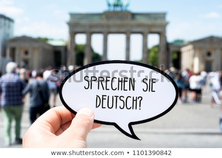 Szöveg tanul Brandenburgi kapu közelkép kéz fiatalember Stock fotó © nito