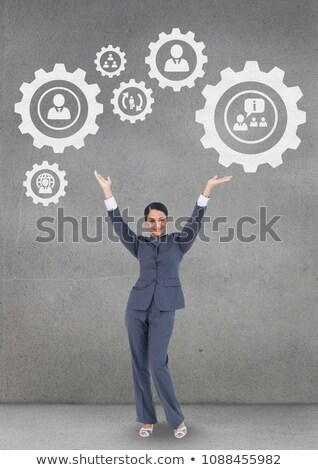 Business woman interacting with people in cogs graphics against grey background Stock photo © wavebreak_media