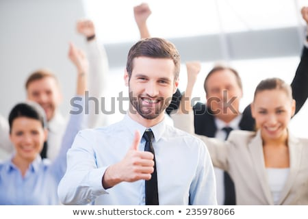 Successful business person raising hands. Stock photo © lichtmeister