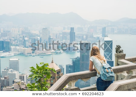 Fiatal nő utazó csúcs háttér Hongkong fa Stock fotó © galitskaya