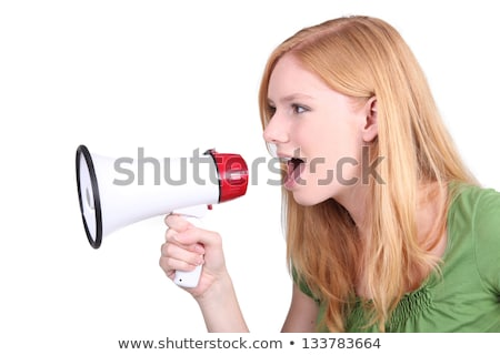 happy teenage girl speaking to megaphone Stock photo © dolgachov