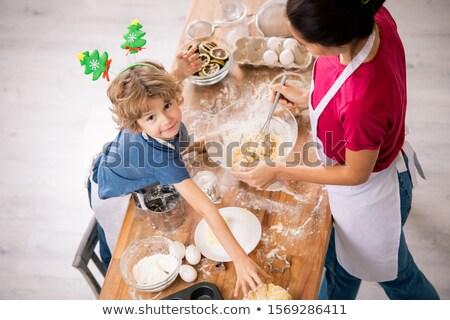 Imádnivaló fiú néz nyújtás kar görbület Stock fotó © pressmaster