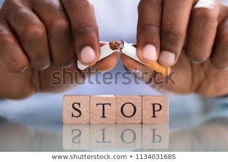 Személyek kéz cigaretta stop kockák közelkép Stock fotó © AndreyPopov