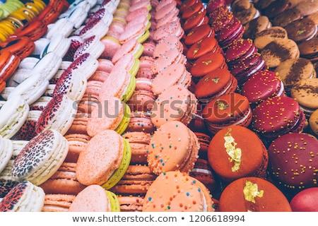 Közelkép citromsárga macaronok cukrászda áll édesség Stock fotó © dolgachov