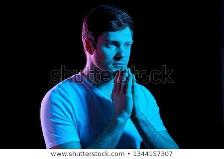 человека молиться Бога фиолетовый неоновых фары Сток-фото © dolgachov