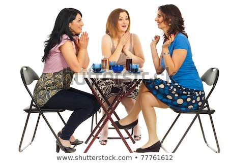 Adult successful woman sitting at a table in a cafe and drinking coffee Stock photo © ElenaBatkova